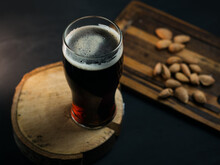 A Glass Of Beer Brown Belgian Ale On A Dark Sto