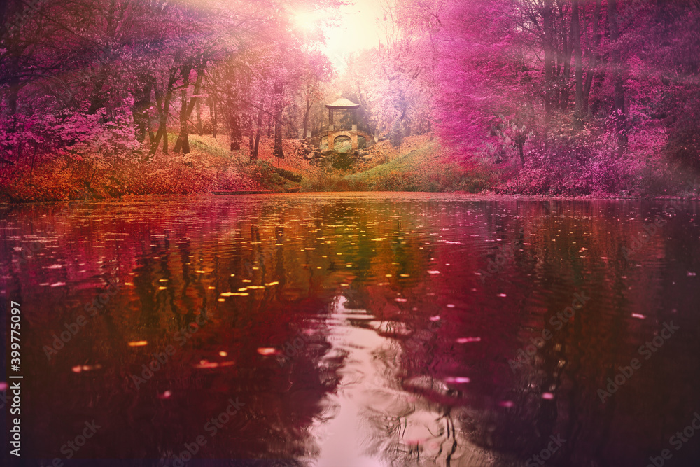 River in the autumn forest at sunset.
