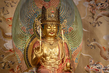 Golden Buddha Statue Inside The Buddha Tooth Relic Temple In Chinatown District, Singapore.