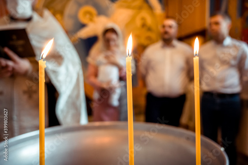 Canvas Candles in the church at the christening of the baby in the temple of God