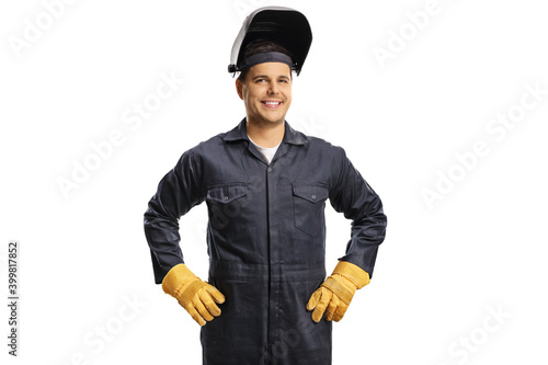 Fotografie, Obraz Smiling welder in a uniform with a protective helmet