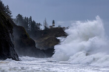 Large Waves Crashing Against Cliffs At Cape Disappointment On The Washington Coast During King Tide
