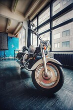 A Large Silver Motorcycle On The Black Floor. Cruiser Chrome