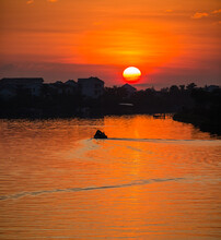 Sunsrise Over The  Thu Bon River  In Hoi An Vietnam