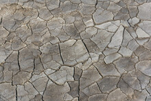 Grey Cracked Dried Soil Textured Background From Mud Volcanoes Park