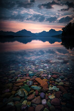 Sunrise Over Lake McDonald At Glacier National Park Reflecting Off The Water