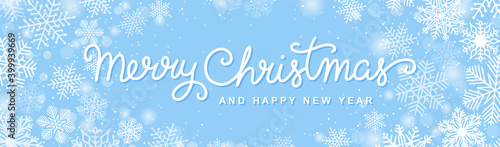 Fototapeta Christmas horizontal banner with hand drawn lettering, snowflakes and snow. Merry Christmas script calligraphy. White on a blue background. Winter holiday vector design.  obraz