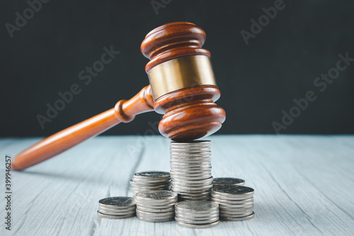 Valokuvatapetti Old wood Judge hammer with stacking coins in close-up and coins stack the table wood background, Used for adjudication and Justice