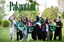 Pakpattan City. Group Of Pakistani Man Wearing Traditional Clothes With National Flags. Biggest Cities Of Pakistan Concept.