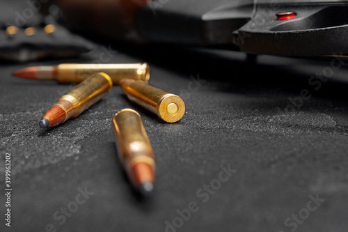 Close up of hunting shotgun and cartridges on dark grey background Fototapet