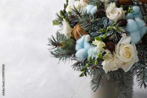 Beautiful wedding winter bouquet on light background, closeup