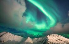 Northern Lights (Aurora Borealis) Over Mountain Peaks Covered With Snow, Sorvaer, Soroya Island, Hasvik, Troms Og Finnmark