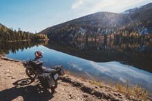 Motorcycle Near Mountain Lake, Sunny Autumn Day In Mountain Motor Journey, Beautiful Reflection In Water
