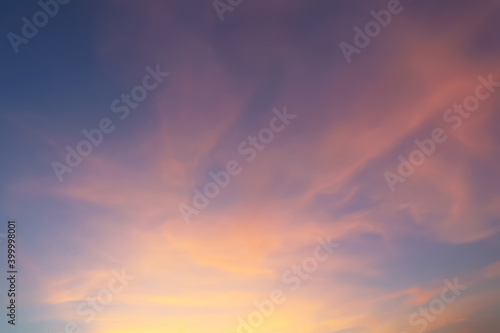 Obraz Dramatic atmosphere panorama view of fantasy twilight sky and soft colorful clouds with vivid shiny golden sunlight for silhouette presentation background. - fototapety do salonu