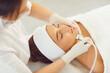 Leinwandbild Motiv Cosmetologist making procedure of microdermabrasion of facial skin for woman