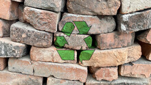Green Recycling Icon On Red Bricks Pile