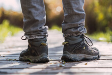 Close Up Shot Of The Feet Of A Person With Gray Hiking Boots
