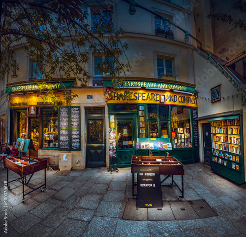 Paris, France - circa May, 2017: Illuminated at night Shakespeare and company library in Paris. It is historic library located in the fifth arrondissement of Paris; it was founded in 1919