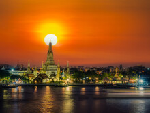 View Of Wat Arun And Chao Phraya River At Sunset. Buddhist Temple And Landmarks In Bangkok Thailand