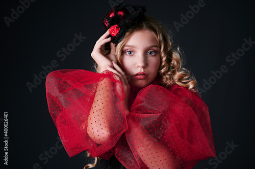 Fotografija retro portrait of a beautiful girl in a red dress