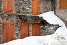 Horizontal Shot Of The Snow Blocking The Entrance Of A Mountain House In Vilamòs, Vall D'Aran, Lleida, Spain