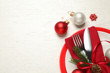 Festive Table Setting With Beautiful Dishware And Christmas Decor On White Wooden Background, Flat Lay. Space For Text