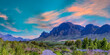 canvas print picture - Panorama shot of Franschhoek wine valley with flowers and blue sky in Western Cape South Africa