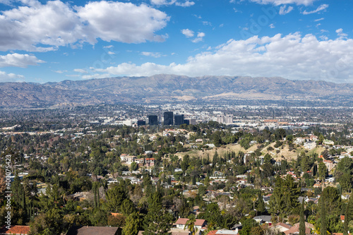 Photo View of Woodland Hills with partly cloudy sky in the west San Fernando Valley area of Los Angeles, California
