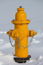 A Shot Of A Yellow Fire Hydrant Out In The Snow In The Winter Time