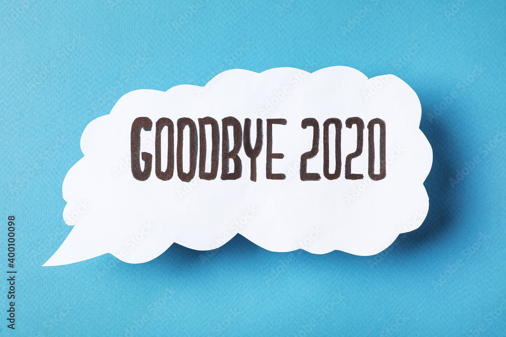 Paper speech balloon with phrase Goodbye 2020 on light blue background