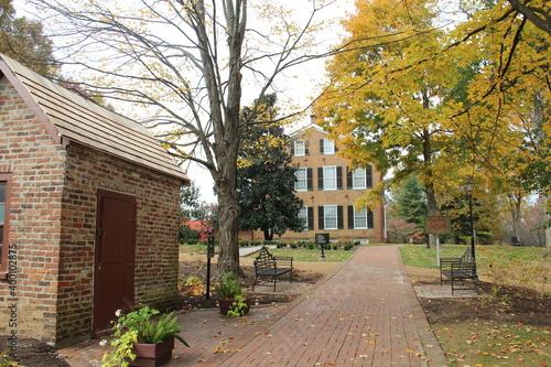 Fototapety, obrazy: Fall tree and brick house in Kentucky.