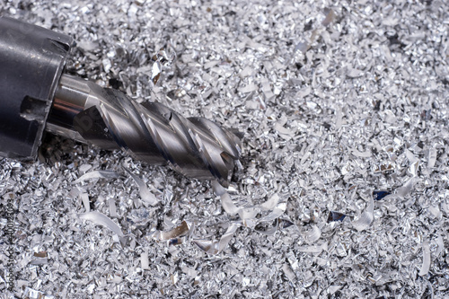 Canvas Print Silver end mill cutter with metal shavings