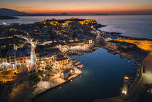 Rethymno Evening City At Crete Island In Greece. The Old Venetian Harbor.