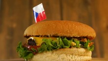 Delicious Burger With Small Czech Flag On Top Of Them With Toothpicks. Yummy Hamburger Rotating.