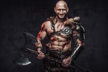 Positive Portrait Of A Happy And Powerful Barbarian With Bloody And Grimy Skin In Light Armour In Dark Background Holding Two Handed Axe.