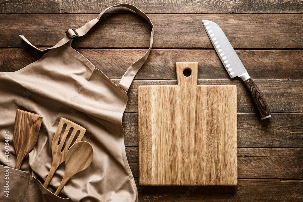 Fototapeta Culinary background, kitchen utensils and apron on kitchen countertop with blank space for any recipe or menu text