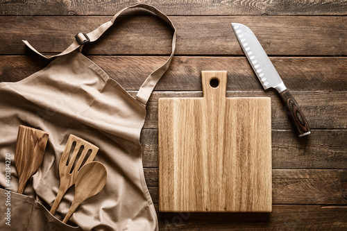 Fototapeta Culinary background, kitchen utensils and apron on kitchen countertop with blank space for any recipe or menu text obraz