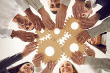 Team Of People Joining Gears As Metaphor For Effective Teamwork And Finding Working Solution
