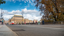 The Legions Bridge, Prague, Czech Republic. Street Scene With A Traditional Tram Passing The Elaborate National Theatre.