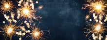 Silvester Party New Year Background Banner - Sparklers And Bokeh Lights On Blue Night Sky Texture, With Space For Text