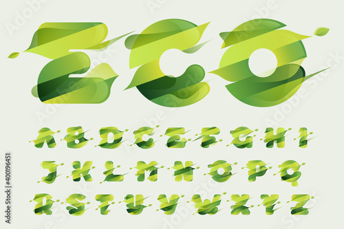 Tela Alphabet with green diagonal stripes, leaves and waves.