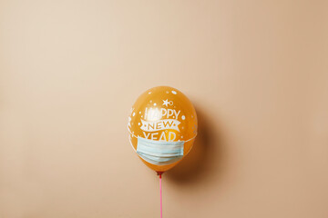 balloon with the text happy new year wearing mask