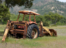 Disassembled Old Rusty Tractor Abandoned In Mountains Valley