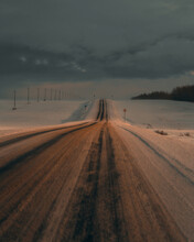A Ray Of Light Falls On A Snow-covered Winter Road