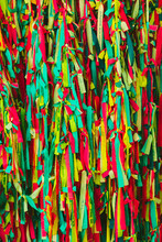 Colorful Scrappy Fabric. Colorful Peaces Of Clothes Be Bind Together On Tree By People Who Believed This Will Exorcise Their Fate.