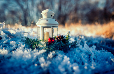 fabulous festive christmas card a candle burns in an elegant spruce wreath stands in the New Year's garden among the snow