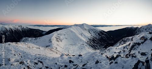 Fototapeta Located in the main ridge of the Tatras two beautiful peaks of the Western Tatras (Rohacz Ostry, Ostry Rohac, Rohac, Rohacz Placzliwy, Placlive, Placliv, Placlivy Rohac) in Slovakia in winter scenery. obraz