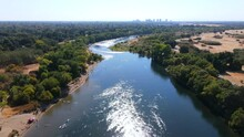 2020 - An Excellent Aerial Shot Of People Wading Into The American River In Sacramento, California.