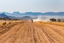 Washboard Gravel Road In Namibia  - Upcoming Cars Giving Big Dust Clouds