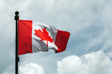 Flag Of Canada On Flagpole Floating In The Sky